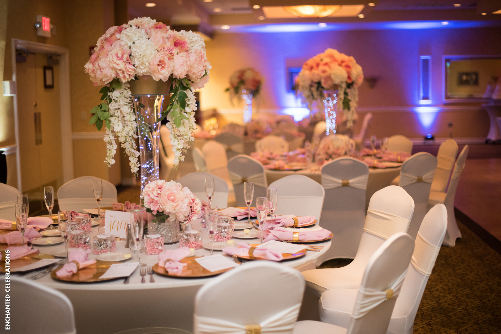 Bride and groom chose to decorate the Atlantis Ballroom in pretty pinks and gold accents.