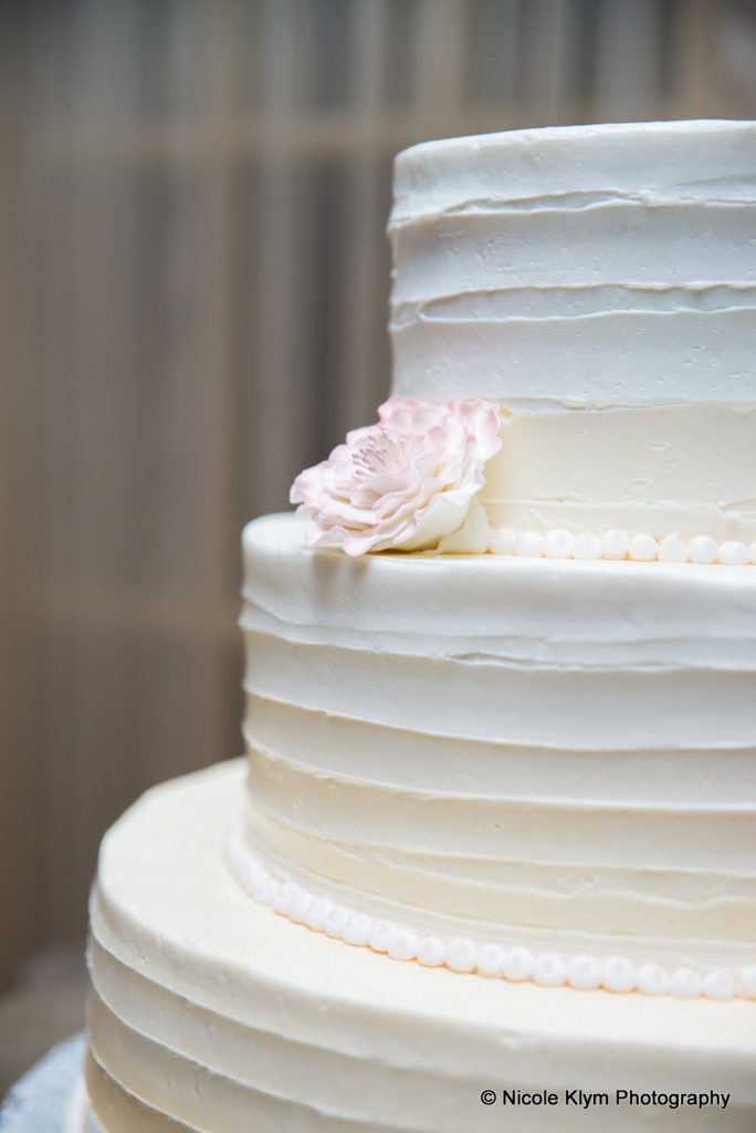 white and pink wedding cake