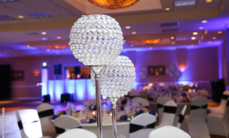 Atlantis and Coral Ballroom wedding packages include beautiful centerpieces.